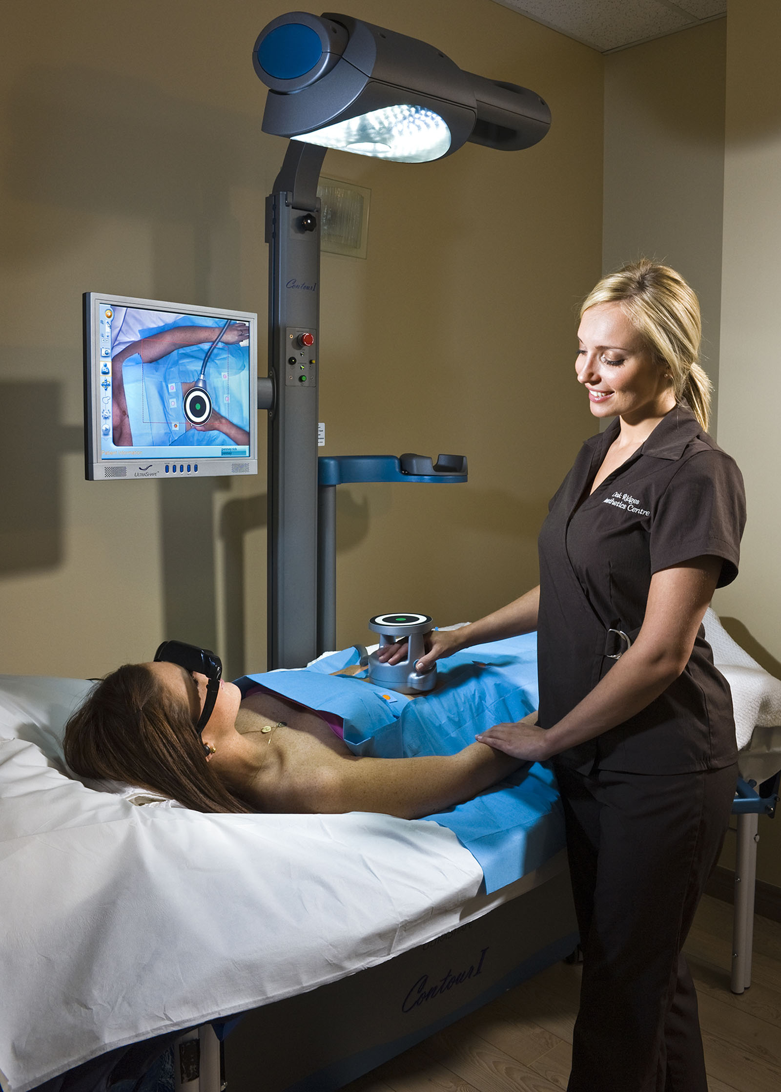 Aesthetics practitioner treating woman at Oakridges Aesthetics Centre