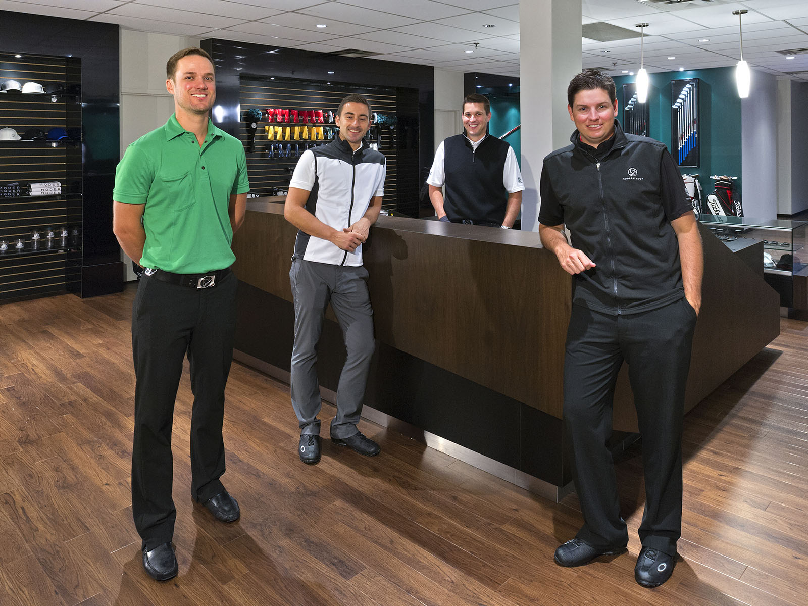 Four members of sales staff in golf pro shop