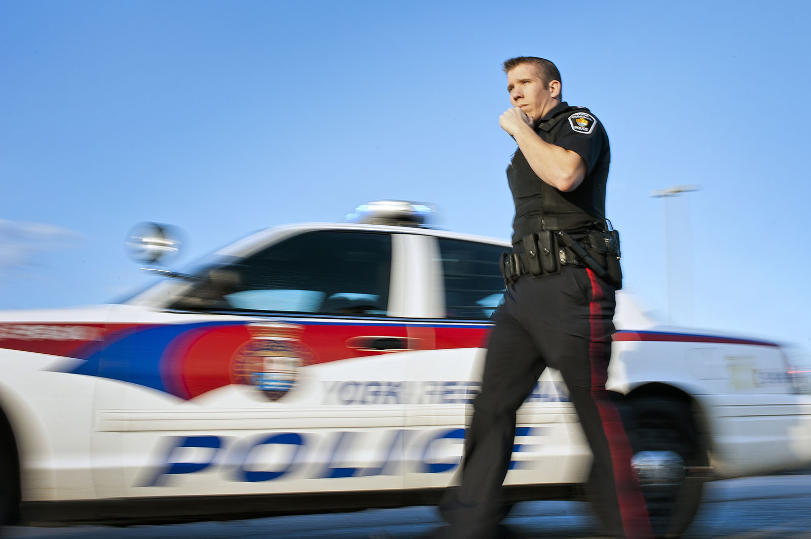 York Regional Police officer standing by police cruiser
