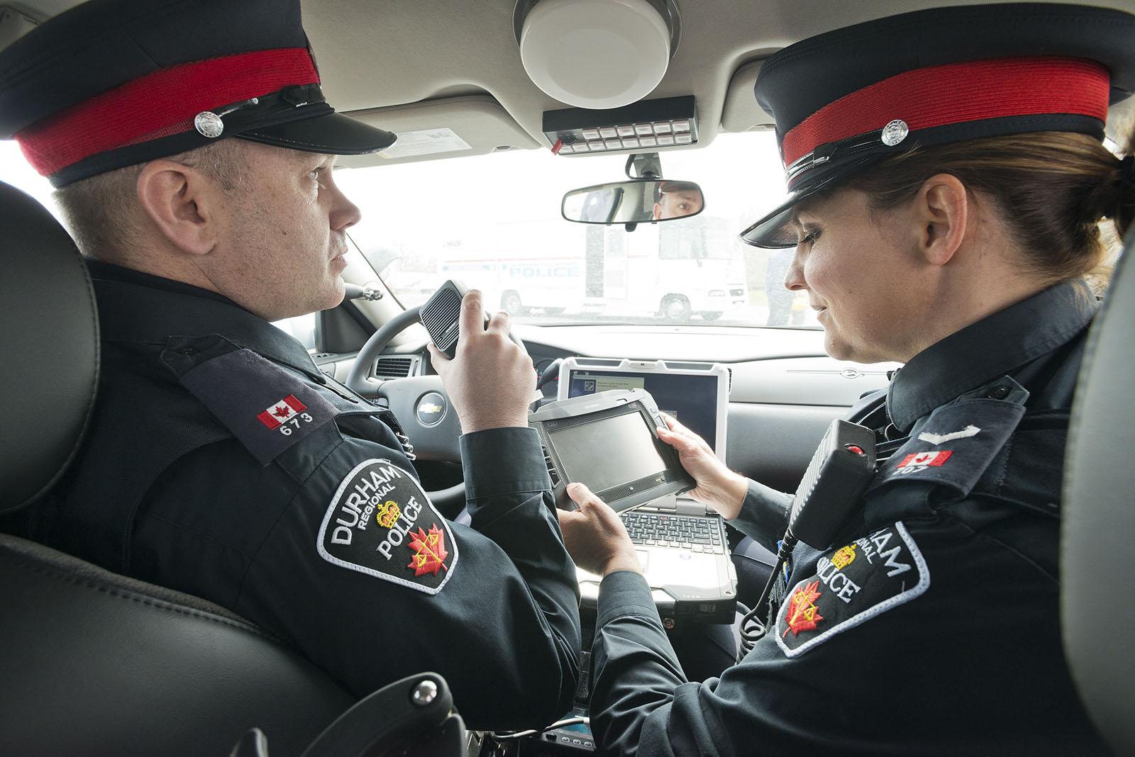 York Regional Police officers inside police cruiser
