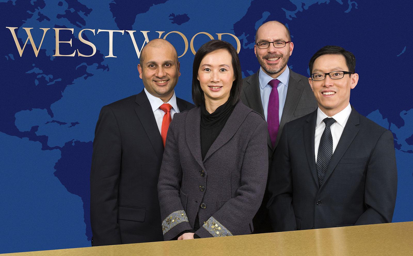 A group portrait of four executives.