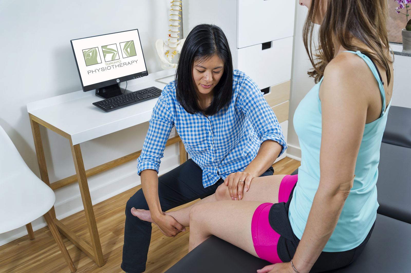 Physiotherapist treats patient's leg