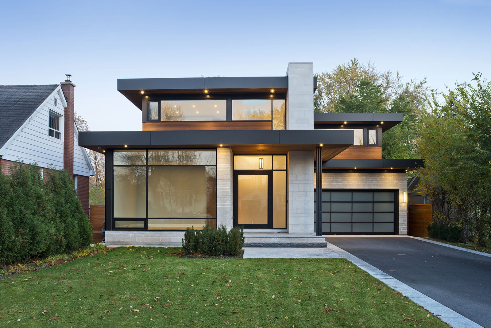 A contemporary styled residential exterior photographed at dusk