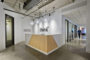 Think TV offices, Toronto reception, man walking down passageway