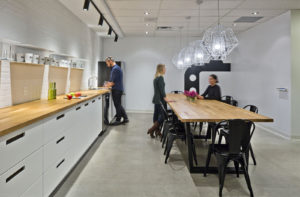 Three employees in Think TV offices cafeteria