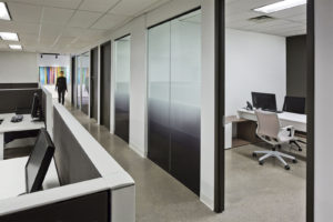 Think TV offices, woman walking down passageway